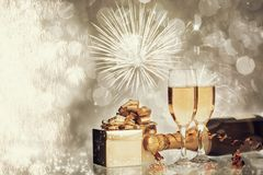 Glasses of champagne on sparkling holiday background with fireworks. On the sky royalty free stock photos