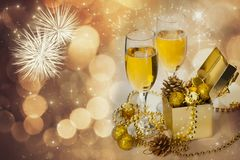 Glasses of champagne on sparkling holiday background with fireworks. On the sky royalty free stock photography