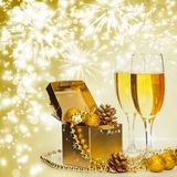 Glasses of champagne on sparkling holiday background with fireworks. On the sky stock photography