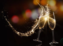 Glasses of champagne with splash Stock Photography