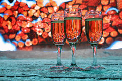 Glasses of champagne stand near screen Royalty Free Stock Photos