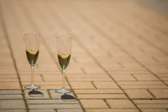 Glasses with champagne standing on the bridge. Glasses with champagne,sunny day, wedding decor,Glasses of champagne soar above the ground Stock Photo