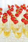 Glasses of champagne with strawberry Stock Photos