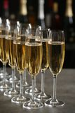 Glasses of champagne on table stock photography