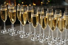 Glasses of champagne on table royalty free stock photography