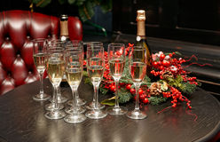 Glasses with champagne on table Stock Photos