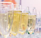 Glasses of champagne on the table Stock Image