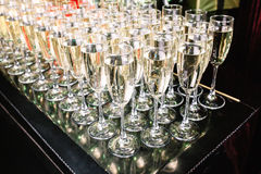 Glasses of champagne on the table Royalty Free Stock Photos