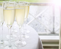Glasses with champagne on a table Royalty Free Stock Photography