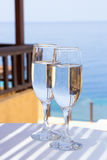 Glasses of champagne on terrace with sea view Stock Photography
