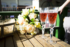 Glasses of champagne. Two glasses of champagne next to the bride's bouquet Stock Photos