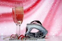 Glasses with champagne and venetian mask Stock Images