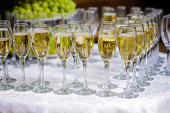 Glasses of champagne waiting for guests Stock Images