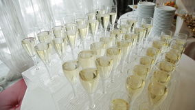 Glasses of champagne at a wedding cocktail party. Glasses of champagne at a cocktail party stock video footage
