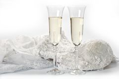 Glasses with champagne and wedding dress on a white background.  Stock Photos