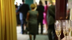 Glasses of champagne at a wedding reception to welcome the bride and groom stock footage