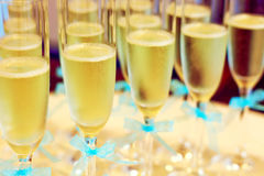 Glasses of champagne with wedding ribbons royalty free stock photography