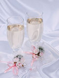 Glasses with champagne and weddings buttonholes Stock Images