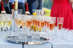 Glasses with champagne and wine on summer wedding Stock Photography