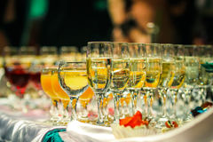 Glasses of champagne and wine wine. Champagne is a sparkling wine produced from grapes grown in the Champagne region of France following rules that demand, among stock images