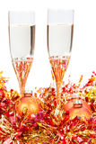 Glasses of champagne at yellow Xmas decorations Royalty Free Stock Photography