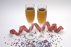 Glasses of champaigne. Two glasses of champaigne with red ribbon and confetti Stock Photo