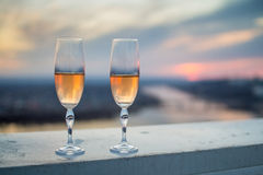 Glasses with champers at sunset Stock Images