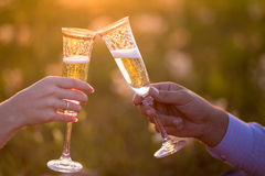 Glasses with champers at sunset Royalty Free Stock Image