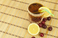 Glasses with cherries with rum. Preparing for summer refreshment cocktail. Cane rum and sugar. Sour pickled in rum Stock Images
