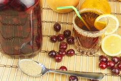 Glasses with cherries with rum. Preparing for summer refreshment cocktail. Cane rum and sugar. Sour pickled in rum Stock Photography