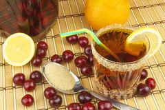 Glasses with cherries with rum. Preparing for summer refreshment cocktail. Cane rum and sugar. Stock Images