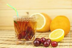 Glasses with cherries with rum. Preparing for summer refreshment cocktail. Cane rum and sugar. Royalty Free Stock Images