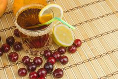 Glasses with cherries with rum. Preparing for summer refreshment cocktail. Cane rum and sugar. Stock Photos
