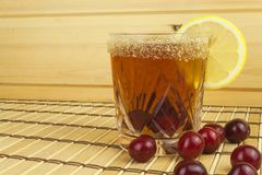 Glasses with cherries with rum. Preparing for summer refreshment cocktail. Cane rum and sugar. Royalty Free Stock Image