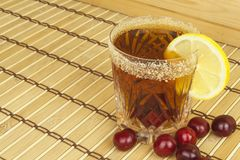 Glasses with cherries with rum. Preparing for summer refreshment cocktail. Cane rum and sugar. Stock Image