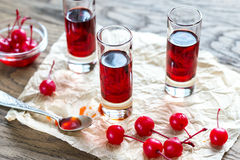 Glasses of cherry brandy with cocktail cherries Royalty Free Stock Photography