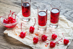 Glasses of cherry brandy with cocktail cherries Royalty Free Stock Photo
