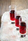 Glasses of cherry brandy Stock Images
