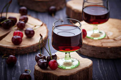 Glasses of cherry liquor. Selective focus Stock Images