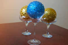 Glasses with  christmas ball. Three glasses with  christmas balls, new Year decoration Royalty Free Stock Photography