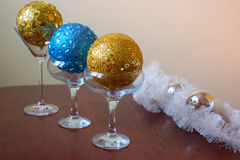 Glasses with  christmas ball. Three glasses with  christmas balls, new Year decoration Royalty Free Stock Photos