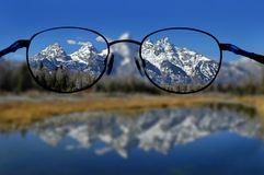 Glasses and Clear Vision of Mountains Stock Photo