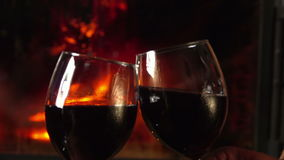 Glasses clink at the fireplace