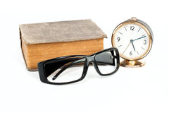 Glasses, clock, book Royalty Free Stock Images