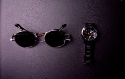 glasses and clock in the style of steampunk on a black background royalty free stock photos