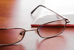 Glasses close-up and open book Royalty Free Stock Photography