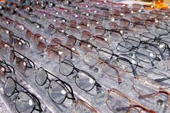 Glasses for close up view in rows many eye glasses stock images