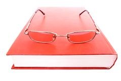 Glasses on a closed book Royalty Free Stock Image