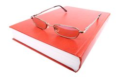 Glasses on a closed book Stock Images