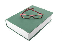 Glasses on the closed book. White background. Camera Pentax k10d kit Stock Image